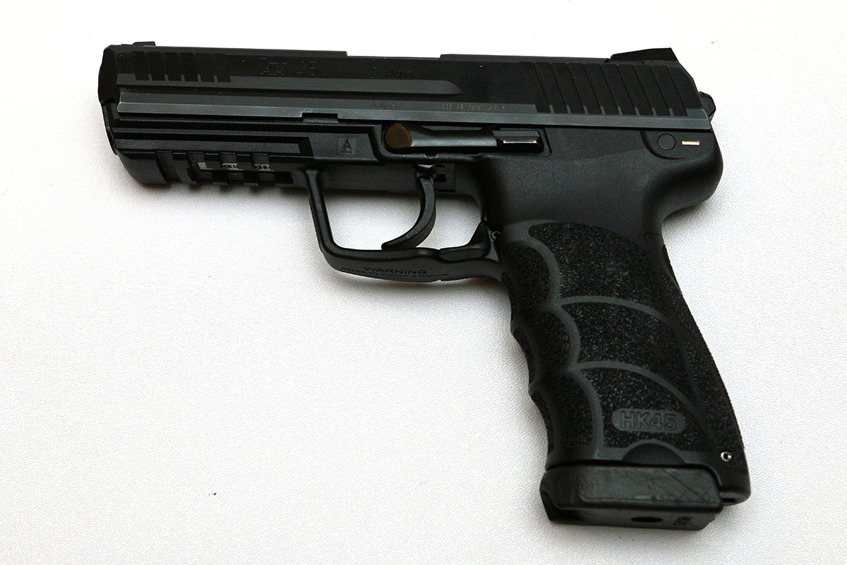 SOLD: HK45 package w/10 mags & weighted blue gun